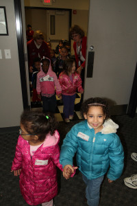 Seeing smiling kids leave with their new coats is the highlight of the day. Click the image to see more photos